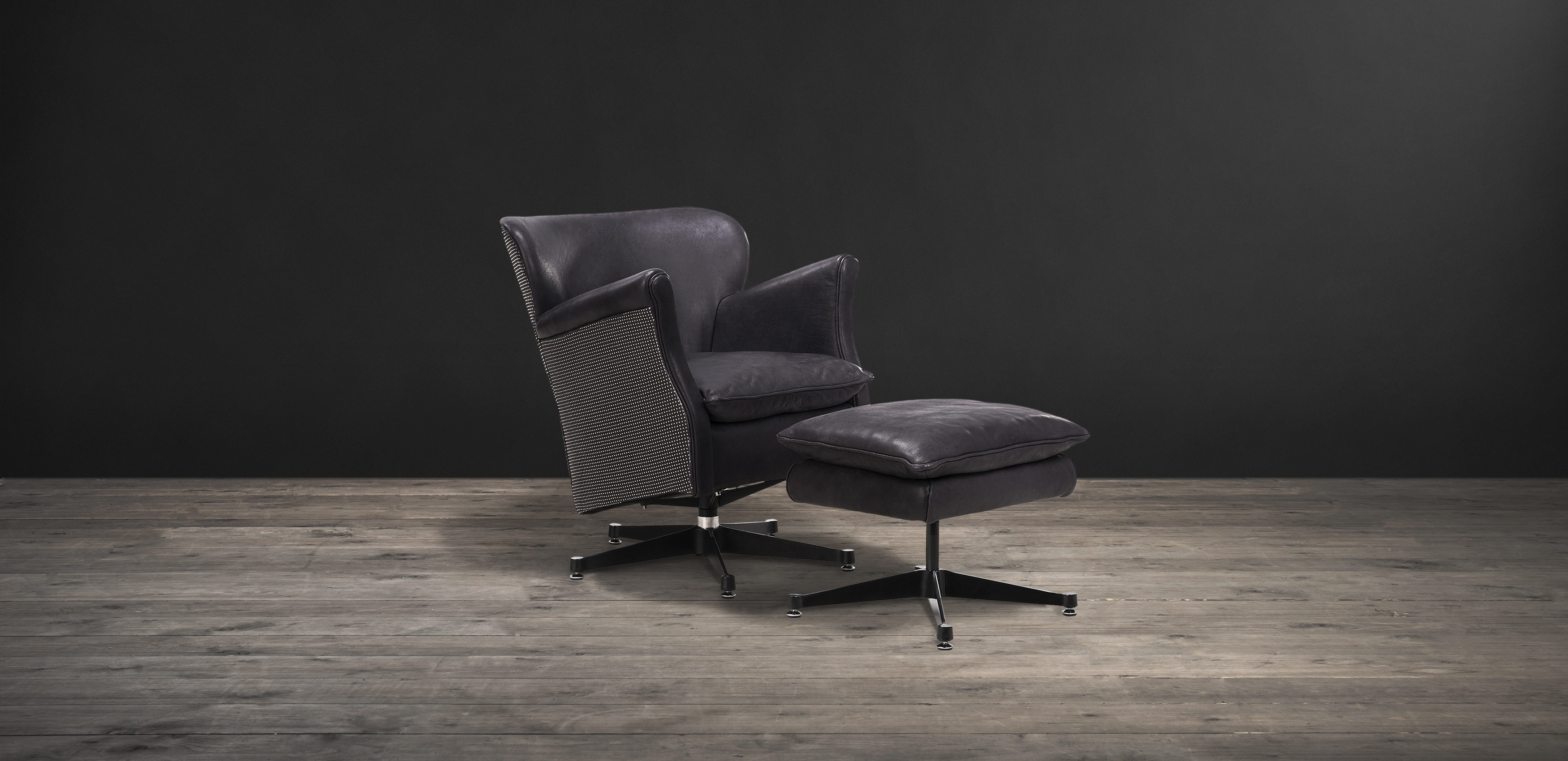 Timothy Oulton armchair in black leather with footstool - Punk Professor