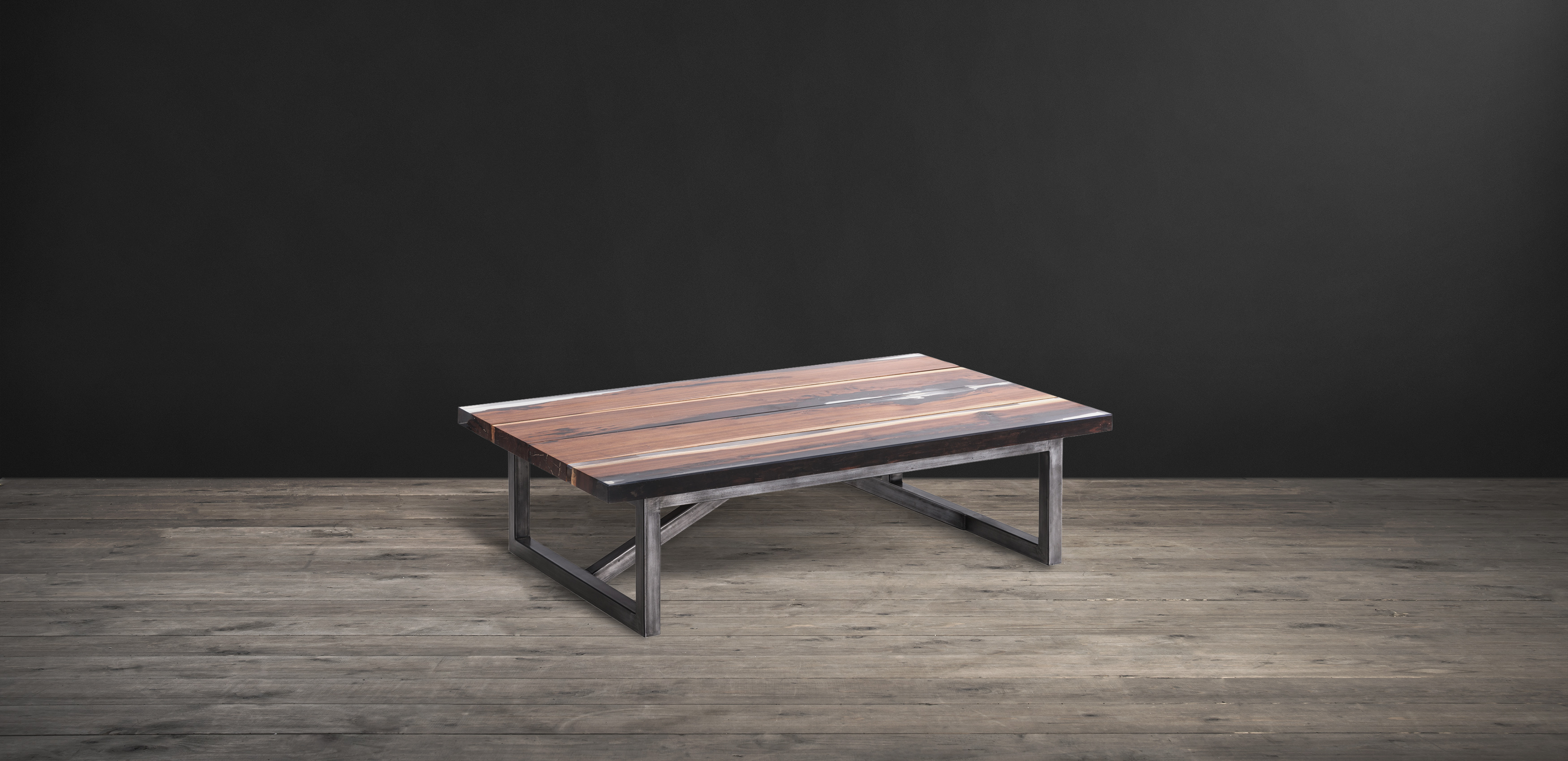 Timothy Oulton coffee table in rosewood, resin, and iron - Trapt